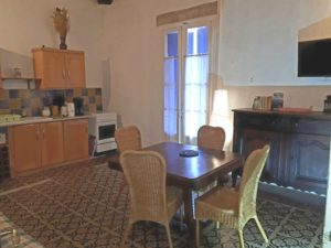 Le Tineiral apartment Les Bruyeres This gite retains much of the character of the property with soft colours and the original tiled floor.